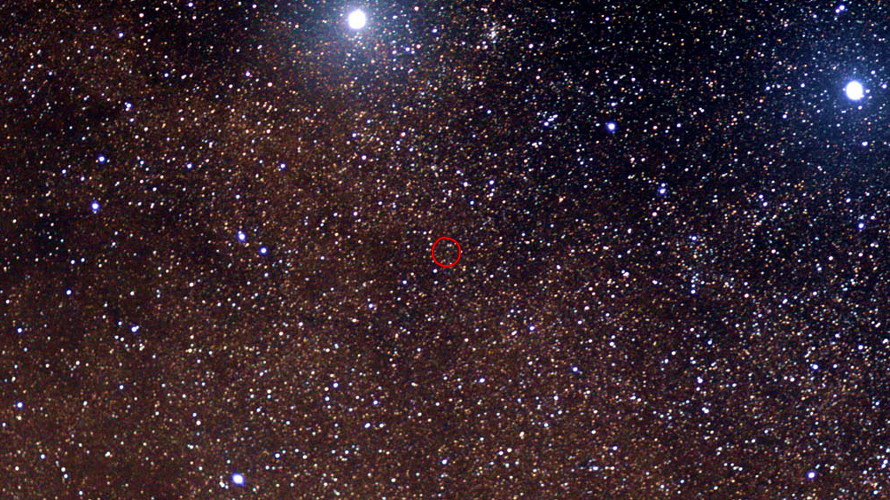 A view of Proxima Centauri (circled) with the much brighter stars Alpha and Beta Centauri visible at the top center and top right, respectively. (Wikipedia)