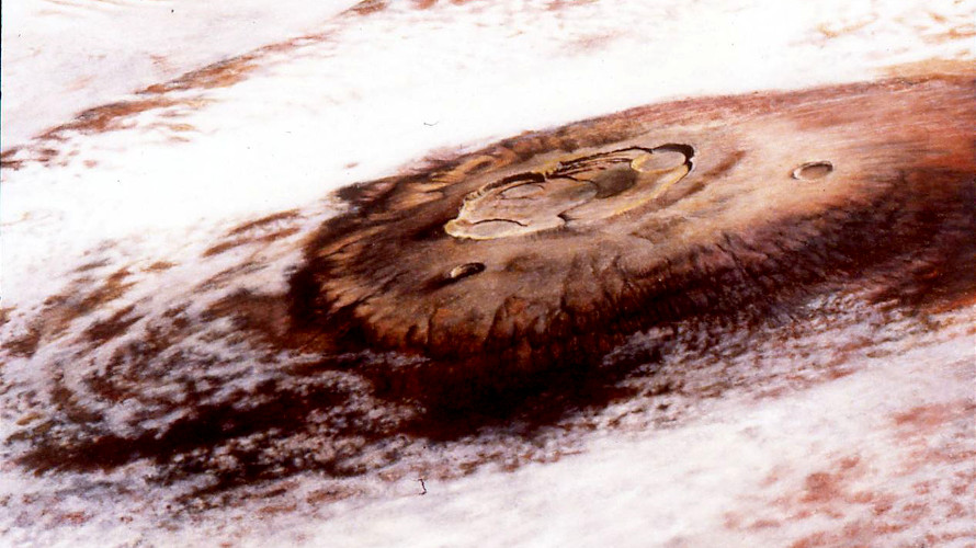 A painting of a cloud-covered Olympus Mons by artist Gordon Legg based on  images from Viking 1. (NASA)