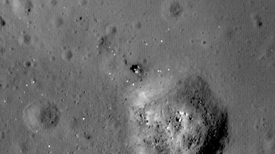 A closeup of Luna 24 acquired in 2012 by NASA's LRO. The white specs in the image are probably fragments from the lander's thermal blankets blown across the lunar surface at lift off. Click on image to enlarge. (NASA/GSFC/Arizona State University)